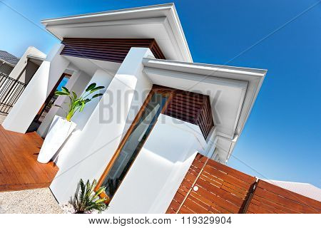 Entrance Of A Luxury House With White Walls And Blue Sky On A Sunny Day