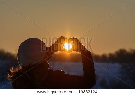 Woman Hands In Winter Gloves. Heart Symbol Shaped, Lifestyle And Feelings Concept With Sunset Light