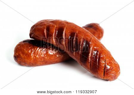 Grilled sausage on a white background