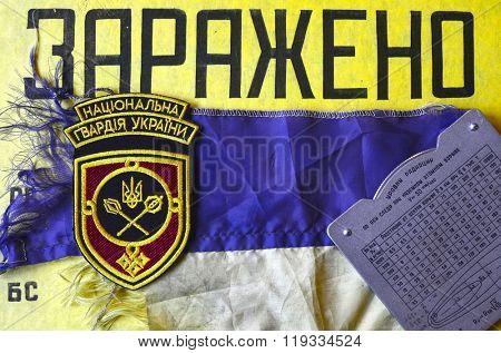 Kiev,Ukraine.FEB 20.Illustrative editorial.Chevron of Ukrainian with CONTAMINATED warning of CD as background (ru)Army.At February 20,2016 in Kiev, Ukraine