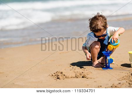 Little Boy Playing With Beach Toys