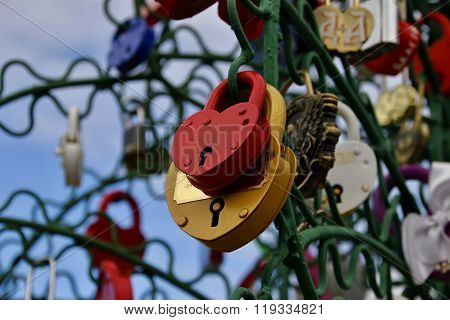 Closed Red And Yellow Padlocks In The Form Of Heart.