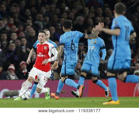 LONDON, ENGLAND - FEBRUARY 23: Mesut Ozil of Arsenal during the Champions League match between Arsenal and Barcelona at The Emirates Stadium
