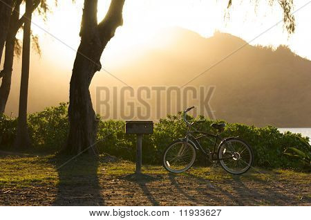 Sunset on Hanalei Bay with Backlit Bike and BBQ.