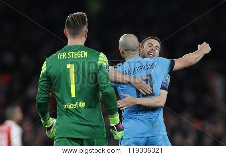 LONDON, ENGLAND - FEBRUARY 23: Marc-Andre ter Stegen of Barcelona and Javier Mascherano celebrate a goal during the Champions League match between Arsenal and Barcelona at The Emirates Stadium