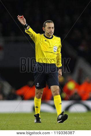 LONDON, ENGLAND - FEBRUARY 23: Referee Cuneyt Cakir during the Champions League match between Arsenal and Barcelona at The Emirates Stadium