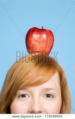 Woman with an apple on top of her head