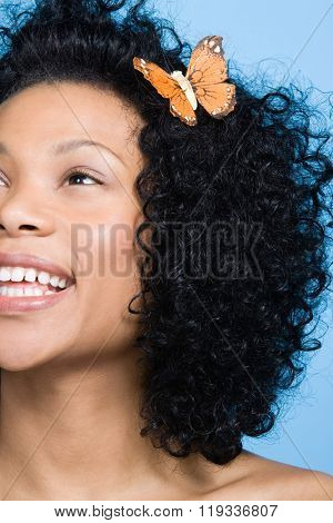 Woman with a butterfly in her hair