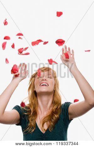 Petals falling on a woman