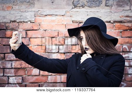 Stylish Teenage Girl With Black Lipstick And Black Hat