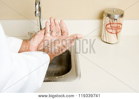 doctor washing his hands