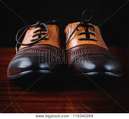 Pairs Of Brown Shoes On The Wooden Table