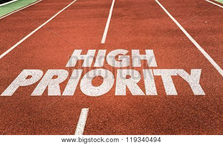 High Priority written on running track