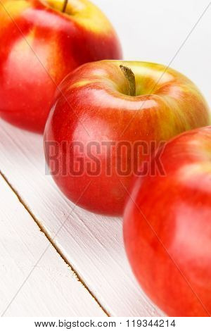 Red apples on a white table