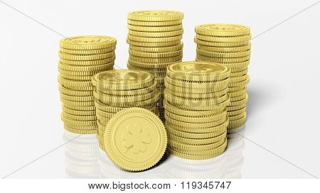 Stacks of golden coins with clover leaf, isolated on white background.