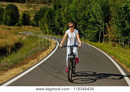 Urban biking - woman riding bike