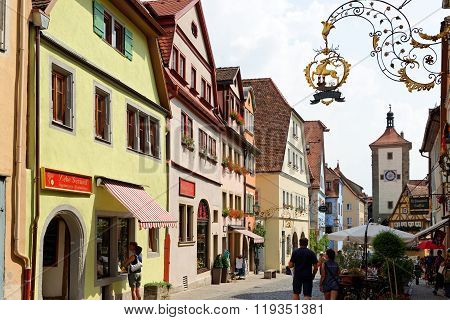 ROTHENBURG OB DER TAUBER GERMANY - AUGUST 10 2015: Schmiedgasse street leading to Plonlein (Little Square) and Siebers Tower (1385) the most photographic place in Rothenburg.