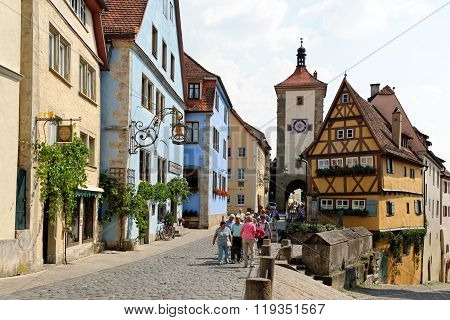 ROTHENBURG OB DER TAUBER GERMANY - AUGUST 10 2015: The famous Plönlein (Little Square) and the Siebers Tower which dates back to 1385. It is one of the most photographed spots in the world.
