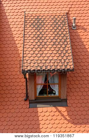 Little dormer in Rothenburg ob der Tauber in Bavaria Germany one of the best-preserved medieval towns in Europe part of the famous Romantic Road tourist route.