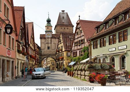 ROTHENBURG OB DER TAUBER GERMANY - AUGUST 10 2015: Markus Tower with Roder arch with its slim clock tower were part of the town's first fortifications (1200).