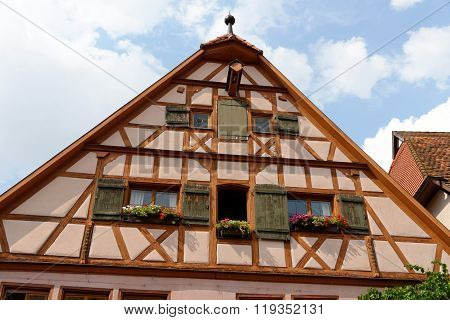 Gable roof of traditional German half-timbered house in medieval section of Rothenburg ob der Tauber Bavaria Germany along the Romantic Road