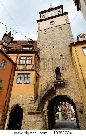 Rothenburg ob der Tauber in Germany. Roder arch with its slim clock tower part of the town's first fortifications (1200). It is one of the best-preserved medieval towns in Europe.