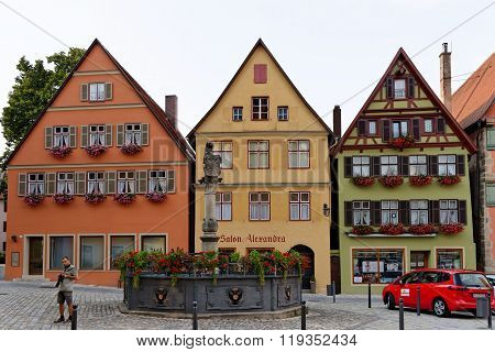 DINKELSBUHL GERMANY - AUGUST 10 2015: Founatain on Altrathausplatz. Dinkelsbuhl is old Franconian town one of the best-preserved medieval urban complexes in Germany.