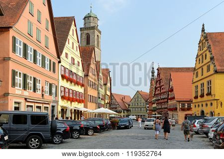 DINKELSBUHL GERMANY - AUGUST 10 2015: Wine market street with its magnificent gabled buildings. Dinkelsbuhl is one of the best-preserved medieval towns in Europe part of the Romantic Road route.