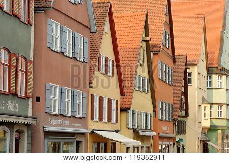 DINKELSBUHL GERMANY - AUGUST 10 2015: Traditional architecture in the old town of Dinkelsbuhl at sunset. It is one of the best-preserved medieval towns in Europe part of the famous Romantic Road.