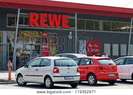 PEITING GERMANY - AUGUST 11 2015: Entrance of a REWE supermarket part of the REWE Group - a German retail and tourism group operating in 14 European countries.
