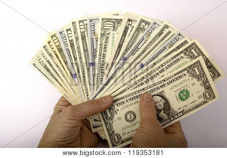 Dollars Of Different Denominations In Hand.