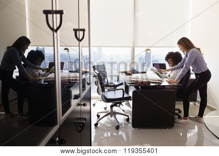 Female Colleagues Architect Using Tablet Pc In Office