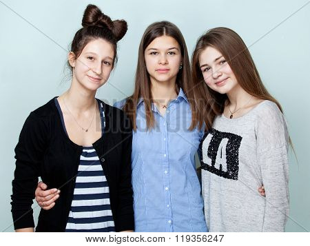 Portrait Of Three Teenage Girls Smiling