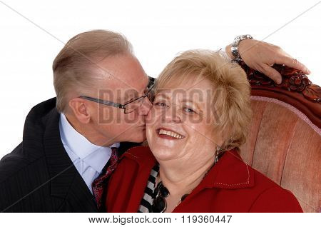 Closeup Of Senior Kissing His Wife.