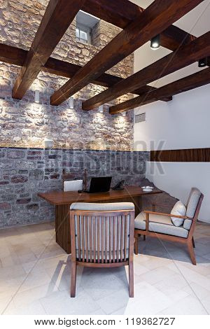 Office room interior with desk and armchair