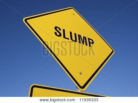 Slump Yellow Road Sign against a Deep Blue Sky