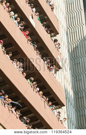 Spectators Watch Dragon Con Parade From High Rise Parking Deck