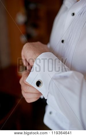 man in the white shirt near the window dress cufflinks