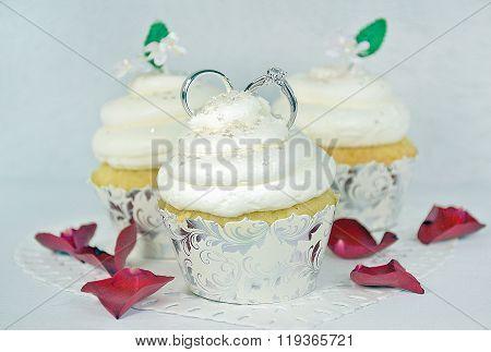 wedding rings in cupcake frosting