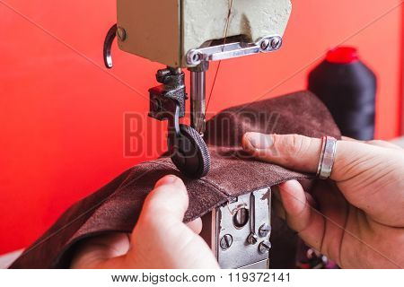 Leather Artisan Manufacturing Handbag At His Atelier. Sewing Process Of The Leather Skin. Leather Wo