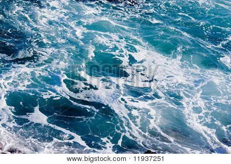 Deep Blue Ominous Ocean Water Background Image.