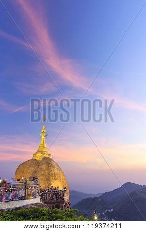 Golden Rock, Kyaikhtiyo Or Kyaiktiyo Pagoda In Twilight Time Crowded With Unidentified Moving Touris