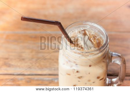 Glass Of Iced Coffee On Wooden Table With Vintage Filter Style