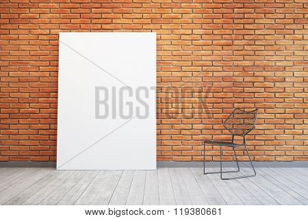 room with blank picture and chair