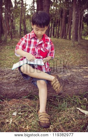 Full Body. Asian Boy Writing On Notebook. Education Concept. Vintage Style.