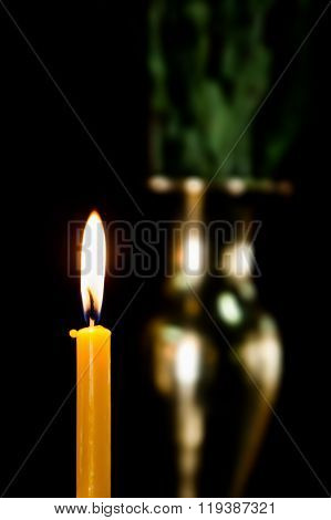 Candlelight In The Dark, With Blurred Brass Vase Background