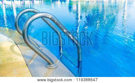 Swimming Pool Bar Ladder In Light Blue Water