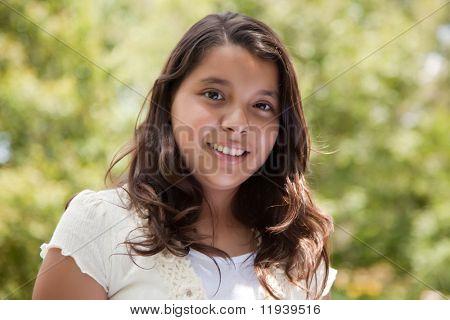 Cute Happy Hispanic Girl in the Park.