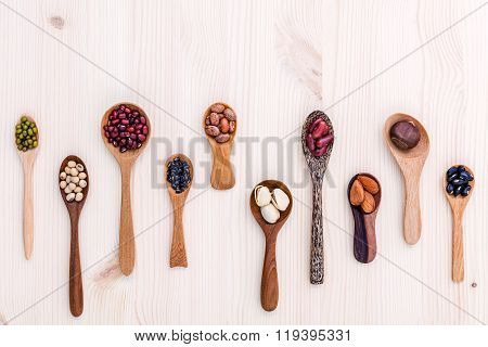 Assortment Of Beans And Lentils In Wooden Spoon Set Up On Wooden Background