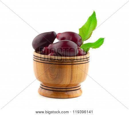 fresh dogwood in a wooden bowl
